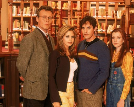 Shot of the leads: Giles, Buffy, Xander, WIllow, standing in the library